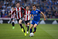 Ben Chilwell of Leicester City brings the ball forward under pressure from John Lundstram of Sheffield United during the Carabao Cup match between Sheffield United and Leicester City at Bramall Lane, Sheffield, England on 22 August 2017. Photo by James Williamson / PRiME Media Images.