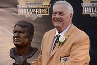 Canton, Ohio - August 6, 2015: Former NFL player Mick Tingelhoff poses with his bust during the 2015 Pro Football Hall of Fame enshrinement in Canton, Ohio August 6, 2015. Tingelhoff played with the Minnesota Vikings from 1962 to 1978 and helped the Vikings attain 10 divisional titles in an 11-season span from 1968 to 1978  (Photo by Don Baxter/Media Images International)