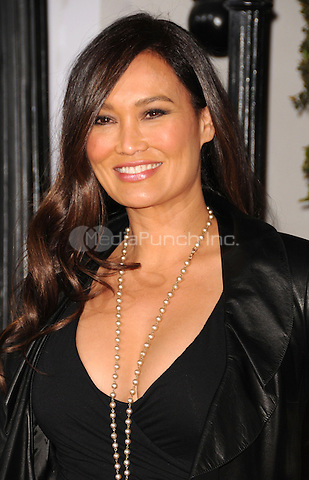 "Tia Carrere at the Los Angeles premiere of ""No Strings Attached""  at the Regency Village Theater in Westwood, CA, USA.January 11, 2011 © mpi11 / MediaPunch Inc."