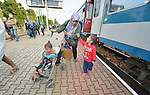 A refugee woman and her two children get off a train that has arrived in the Hungarian town of Hegyeshalom. Migrants and refugees aboard the train walk from here across the border into Austria. Hundreds of thousands of refugees and migrants flowed through Hungary in 2015, on their way to western Europe from Syria, Iraq and other countries.