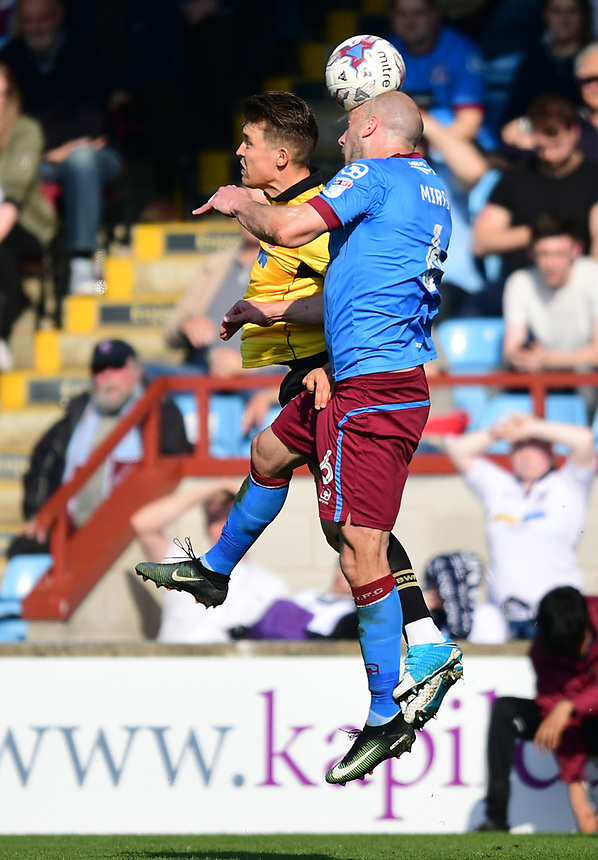Bolton Wanderers' Max Clayton vies for possession with Scunthorpe United's David Mirfin<br /> <br /> Photographer Chris Vaughan/CameraSport<br /> <br /> The EFL Sky Bet League One - Scunthorpe United v Bolton Wanderers - Saturday 8th April 2017 - Glanford Park - Scunthorpe<br /> <br /> World Copyright &copy; 2017 CameraSport. All rights reserved. 43 Linden Ave. Countesthorpe. Leicester. England. LE8 5PG - Tel: +44 (0) 116 277 4147 - admin@camerasport.com - www.camerasport.com
