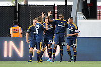 Edson Buddle (14) of the Los Angeles Galaxy celebrates scoring with teammates during a Major League Soccer (MLS) match against the New York Red Bulls .at Red Bull Arena in Harrison, NJ, on August 14, 2010.