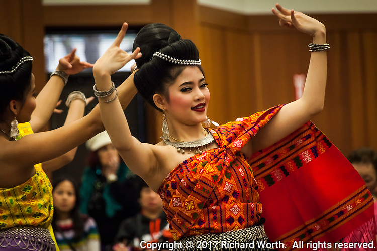 Delicate hand motions, part of the dance celebrating the Lunar New Year.