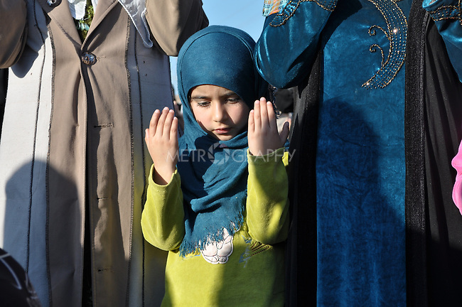 GOIZHA, IRAQ: An Iraqi Kurdish girl prays for rain...The current fall and winter have been extremely dry in northern Iraq.  A number of Islamic parties in the north of the country organized mass prayer gatherings to combat the coming drought...Photo by Sartep Osman/Metrography