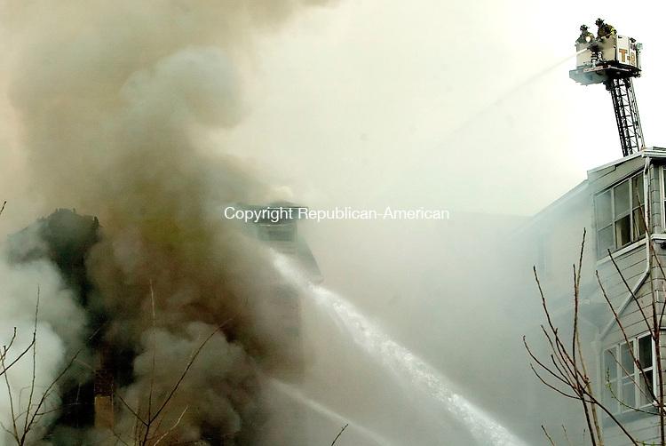 WATERBURY, CT--27 APRIL 2007--042707JS03- Waterbury firefighters battle a blaze at 151 Locust Street in Waterbury on Friday. <br /> Jim Shannon / Republican-American