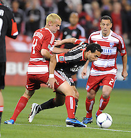 D.C. United forward Dwayne De Rosario (7) goes against FC Dallas midfielder Andrew Jacobson (4) D.C. United defeated FC Dallas 4-1 at RFK Stadium, Friday March 30, 2012.