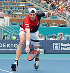 March 31, 2019: John Isner (USA) is defeated by Roger Federer (SUI) 1-6, 4-6, at the Miami Open being played at Hard Rock Stadium in Miami, Florida. ©Karla Kinne/Tennisclix 2010/CSM