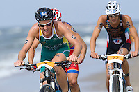 13 JUL 2013 - DEN HAAG, NED - Ben Allen (AUS) (left) of Australia leads Ruben Ruzafa (ESP) (hidden centre, in red with blue and yellow) of Spain and Brice Daubord (FRA) (right) of France along the beach during the bike at the 2013 ITU Elite Men's Cross Triathlon World Championships in Kijkduin, Den Haag (The Hague), the Netherlands (PHOTO COPYRIGHT © 2013 NIGEL FARROW, ALL RIGHTS RESERVED)