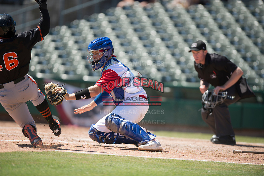 Stockton Ports catcher JJ Schwarz (29) prepares to apply the tag to Jean Angomas (46) in front of home plate umpire Chris Presley-Murphy during a California League game against the San Jose Giants on April 9, 2019 in Stockton, California. San Jose defeated Stockton 4-3. (Zachary Lucy/Four Seam Images)