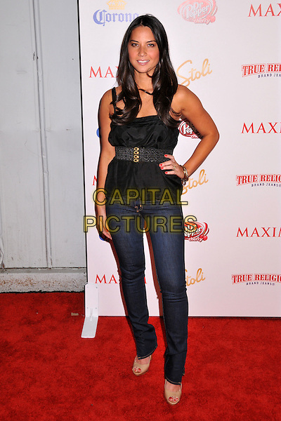 OLIVIA MUNN .Maxim Magazine's 10th Annual Hot 100 Celebration held at Barker Hangar, Santa Monica, CA, USA..May 13th, 2009.full length black top jeans denim hand on hip .CAP/ADM/BP.©Byron Purvis/AdMedia/Capital Pictures.