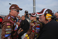 Feb 11, 2007; Daytona, FL, USA; Nascar Nextel Cup driver Ricky Rudd (88) talks with teammate David Gilliland (38) and crew chief Todd Parrott during qualifying for the Daytona 500 at Daytona International Speedway. Gilliland qualified on the pole while Rudd qualified second. Mandatory Credit: Mark J. Rebilas