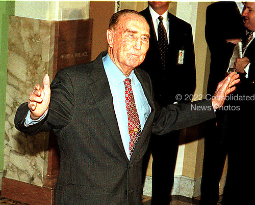 United States Senator Strom Thurmond (Republican of South Carolina) acknowledges photographers as he walks to the U.S. Senate Chamber in the U.S. Capitol in Washington, D.C. prior to the start of the U.S. House presentation in the Impeachment Trial of President Clinton on January 14, 1999..Credit: Ron Sachs / CNP