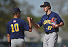 Chris DeSousa #27, Massapequa pitcher, right, gets a fist bump from third baseman Johnny Castagnozzi #10 as he works out of a jam in a Nassau County varsity baseball game against host Farmingdale High School on Tuesday, May 2, 2017. DeSousa held Farmingdale scoreless over 4 2/3 innings of work and was the winning pitcher of record in Massapequa's 10-1 victory.