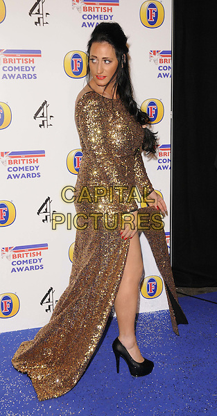 Lauren Socha.attended the British Comedy Awards 2011, Fountain Studios, Wembley, London, England, UK, .16th December 2011..arrivals full length gold dress long sleeve sequined sequin dress slit split maxi black shoes side .CAP/CAN.©Can Nguyen/Capital Pictures.