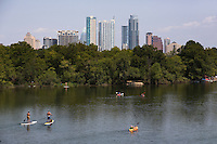 Weekdays and weekends alike are a Stand Up Paddler's paradise on Austin's Lady Bird Lake, the SUP capital of Texas.