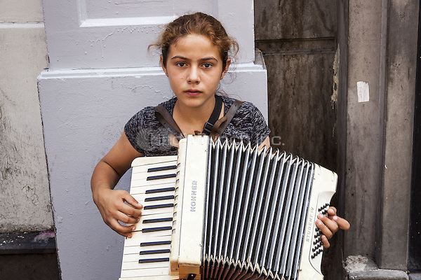 Young girl playing an accordion in a street, Istanbul, Turkey  May 2015.<br /> CAP/MEL<br /> &copy;MEL/Capital Pictures /MediaPunch ***NORTH AND SOUTH AMERICA ONLY***