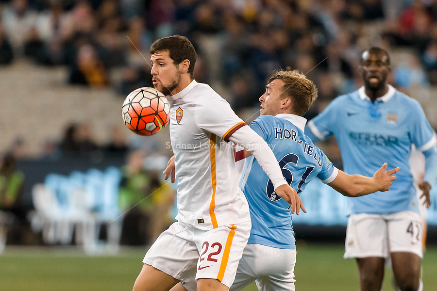 Melbourne, 21 July 2015 - Mattia Destro of AS Roma and James Horsfield of Manchester City fight for the ball in game two of the International Champions Cup match at the Melbourne Cricket Ground, Australia. City def Roma 5-4 in Penalties. (Photo Sydney Low / AsteriskImages.com)