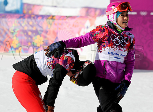 19.02.2014. Sochi, Russia.  Rosa Khutor   Sochi Winter Olympic Wiomens Giant Parallel Slalom Snowboarding.  Competitors Patrizia Kummer (SUI) and Tomoka Takeuchi (JPN) congratulate each other