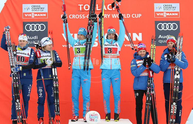 Ladies podium with from left, Sweden, Russia and Norway. Team sprint of the FIS Cross Country Ski World Cup  in Dobbiaco, Toblach, on January 15, 2017. For ladies Russia wins ahead of Sweden and Norway. For men's Canada wins ahead of Sweden and Italy's with Dietmar Noeckler and Federico Pellegrino. Credit: Pierre Teyssot