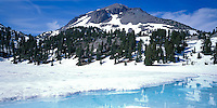 Lassen Volcanic National Park, CA<br /> The shoreline of Lake Helen with ice floes at spring melt, Lassen Peak in the distance