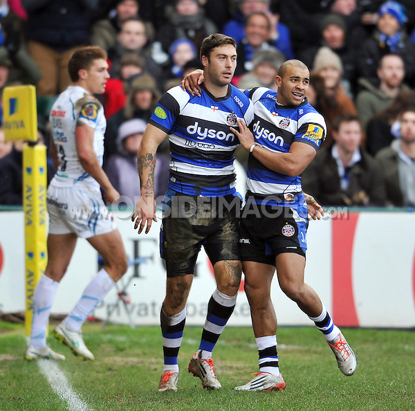 Matt Banahan of Bath Rugby celebrates a try with Jonathan Joseph but the score is later ruled out. Aviva Premiership match, between Bath Rugby and Exeter Chiefs on December 27, 2014 at the Recreation Ground in Bath, England. Photo by: Patrick Khachfe / Onside Images