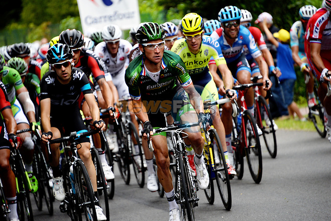 Thomas Voeckler (FRA) Team Europcar attacks out of the peleton with 19km to go at Cote de Maron during Stage 7 of the 2014 Tour de France running 234.5km from Epernay to Nancy. 11th July 2014.<br /> Photo ASO/G.Demouveaux/www.newsfile.ie
