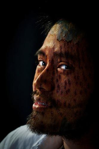 Portrait of an Asian male shot in a studio.