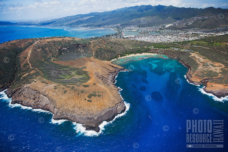 An aerial shot on a clear day of Hanauma Bay facing Hawai'i Kai and the Ko'olau Mountain Range, O'ahu.