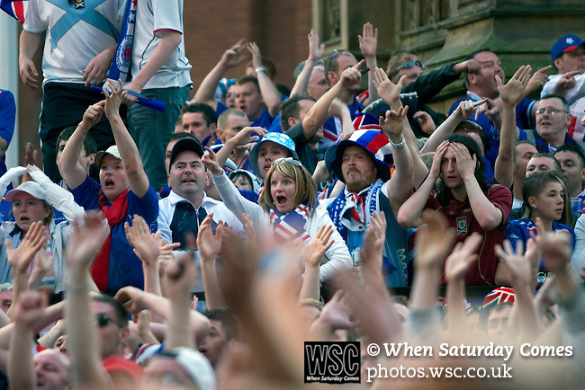 Rangers Fans in Manchester, 14/05/2008. Albert Square, UEFA Cup Final. Fans of Glasgow Rangers in the centre of Manchester watching the UEFA Cup final against Zenit St. Petersburg on a large screen in Albert Square, the location of one of the UEFA Fan Zones. The match was staged at the City of Manchester Stadium and was won by the Russian team by two goals to nil. It was Rangers' first European final appearance since they won the Cup-Winners Cup in 1972 and around 150,000 fans gathered in Manchester. Photo by Colin McPherson.