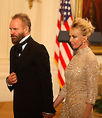 Washington, DC - December 6, 2009 -- Musician Sting and wife, Trudie Styler find their seats prior to a White House East Room reception for the recipients of the 2009 Kennedy Center Honors, in Washington, DC, , Sunday, December 6, 2009..Credit: Martin H. Simon / Pool via CNP