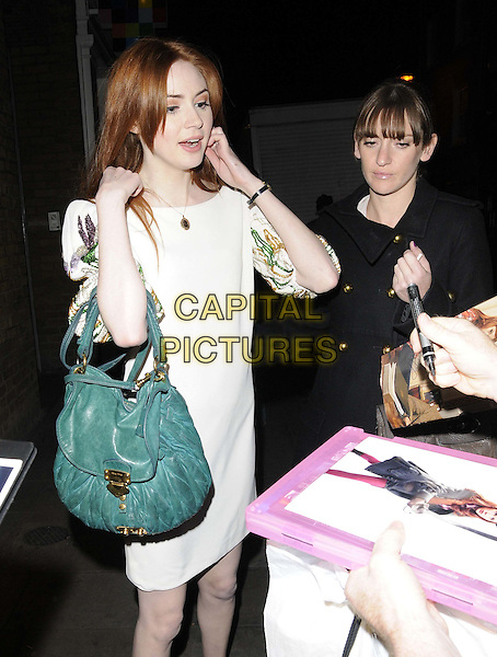 "Karen Gillan .departed after the press night performance in ""Inadmissible Evidence"", Donmar Warehouse theatre, Earlham St., London, England..October 18th, 2011.half length 3/4 white dress green bag purse mouth open signing autographs .CAP/CAN.©Can Nguyen/Capital Pictures."