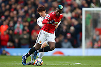 Ki Sung-Yueng of Swansea City competes with Paul Pogba of Manchester United during the Premier League match between Manchester United and Swansea City at the Old Trafford, Manchester, England, UK. Saturday 31 March 2018