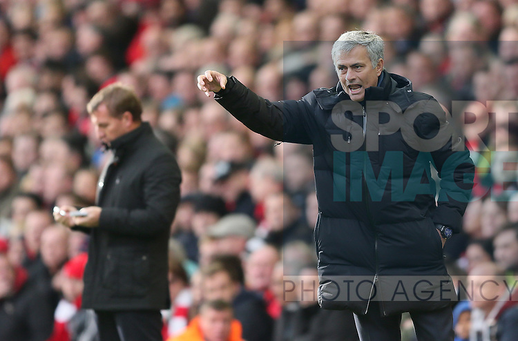 Jose Mourinho manager of Chelsea send s out instructions while Brendan Rodgers manager of Liverpool writes notes  - Barclays Premier League - Liverpool vs Chelsea - Anfield Stadium - Liverpool - England - 8th November 2014  - Picture Simon Bellis/Sportimage