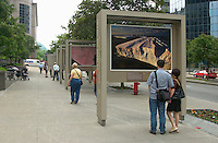 June 21, 2002, Montreal, Quebec, Canada<br /> <br /> Passers by look at a display of aerial photography by French Photographer Yann Arthus-Bertrand, on McGill College Street in downtown Montreal, June 21, 2002.<br /> <br />  Arthus-Bertrand spend many years photographing all countries of the world from the sky, using plane, choppers, hot air balloon, delatplane.<br /> <br /> Mandatory Credit: Photo by Pierre Roussel- Images Distribution. (©) Copyright 2002 by Pierre Roussel <br /> Photos displayed are (c) Yann  Arthus-Bertrand<br /> <br /> NOTE l Nikon D-1 jpeg opened with Qimage icc profile, saved in Adobe 1998 RGB.