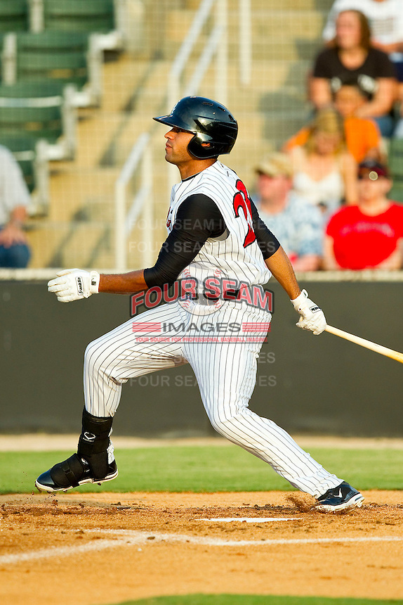 Keenyn Walker #23 of the Kannapolis Intimidators follows through on his swing against the Greensboro Grasshoppers at CMC-Northeast Stadium on July 4, 2012 in Kannapolis, North Carolina.  The Intimidators defeated the Grasshoppers 6-1.  (Brian Westerholt/Four Seam Images)