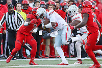 College Park, MD - November 12, 2016: Ohio State Buckeyes quarterback J.T. Barrett (16) is tackled by Maryland Terrapins defensive back JC Jackson (7) during game between Ohio St. and Maryland at  Capital One Field at Maryland Stadium in College Park, MD.  (Photo by Elliott Brown/Media Images International)