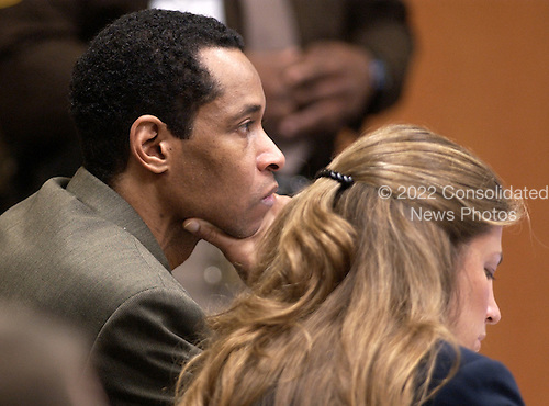 Sniper suspect John Allen Muhammad, left, listens to testimony along with defense attorney Christie Leary during his trial in courtroom 10 at the Virginia Beach Circuit Court in Virginia Beach, Virginia on October 29, 2003. <br /> Credit: Dave Ellis - Pool via CNP