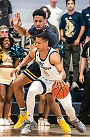WASHINGTON, DC - FEBRUARY 22: Armel Potter #2 of George Washington dribbles past Scott Spencer #2 of La Salle during a game between La Salle and George Washington at Charles E Smith Center on February 22, 2020 in Washington, DC.