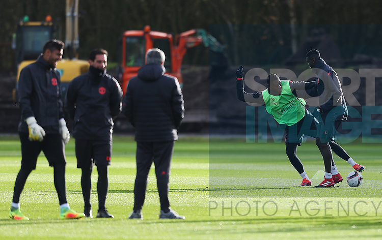 Manchester United manager Jose Mourinho watches Paul Pogba and Tim Fosu-Mensah during the UEFA Europa League training session at the AON Training Complex, Manchester. Picture date: November 23rd 2016. Pic Matt McNulty/Sportimage