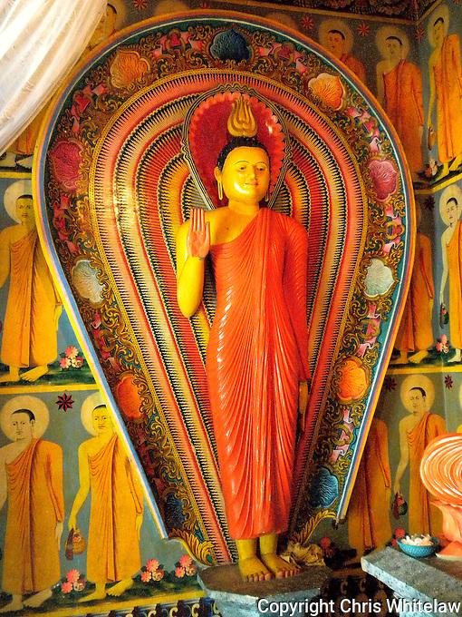 Standing Buddha (protection pose), Kodawa Vihara, near Ambalangoda, Sri Lanka