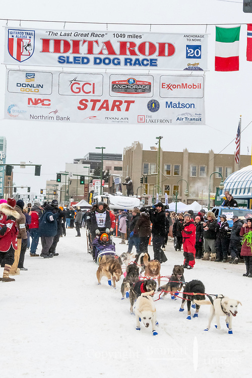 Magnus Kaltenborn and team leave the ceremonial start line with an Iditarider and handler at 4th Avenue and D street in downtown Anchorage, Alaska on Saturday March 7th during the 2020 Iditarod race. Photo copyright by Cathy Hart Photography.com