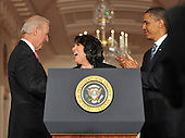 Washington, D.C. - May 26, 2009 -- Judge Sonia Sotomayor of the Federal Appeals Court , center, shakes hands with United States Vice President Joseph Biden, left, after United States President Barack Obama, right, named her as his nominee for Justice of the U.S. Supreme Court in the East Room of the White House on Tuesday, May 26, 2009.  She will replace retiring Justice David Souter. Judge Sotomayor, 54, of The Bronx, New York, will be the first Hispanic to serve if her nomination is approved by the U.S. Senate.  .Credit: Ron Sachs / Pool via CNP