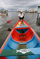 Dweller of stilt houses in Lake Maracaibo in Venezuela using his fishing boat for transportation..