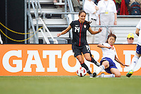 14 MAY 2011: USA Women's National Team defender Stephanie Cox (14) and Japan National team Kozue Ando during the International Friendly soccer match between Japan WNT vs USA WNT at Crew Stadium in Columbus, Ohio.