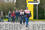 Employees of Liebherr on strike outside the plant on Friday..
