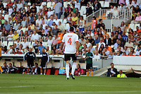 Valencia, Spain. Thursday 19 September 2013<br /> Pictured: Adil Rami of Valencia is walking off the pitch after shown a red card by match referee for his foul against Wilfried Bony of Swansea<br /> Re: UEFA Europa League game against Valencia C.F v Swansea City FC, at the Estadio Mestalla, Spain,