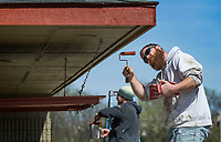 Joe Guthery (left) and Jeff Nugent with Divine Finishes based in Bentonville paint Saturday, March 21, 2020, at Phillips Park in Bentonville. The company is painting and refinishing floors at the restroom and concessions building at the park this week. Check out nwaonline.com/200321Daily/ for today's photo gallery.<br /> (NWA Democrat-Gazette/Ben Goff)