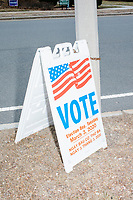 """A sign featuring an American flag and reading """"Vote"""" indicates the location of the Holy Name Parish Hall polling place on the day of the Massachusetts presidential primary on Super Tuesday in West Roxbury, Massachusetts, on Tue., March 3, 2020."""