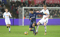 Dele Alli of Spurs holds off Sam Clucas of Swansea City during the Premier League match between Swansea City and Tottenham Hotspur at the Liberty Stadium, Swansea, Wales on 2 January 2018. Photo by Mark Hawkins / PRiME Media Images.