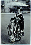 Kyoto, Japan..Mineko Iwasaki, age 6, with one of her teachers from the geisha house she was sold to...All photographs ©2003 Stuart Isett.All rights reserved.